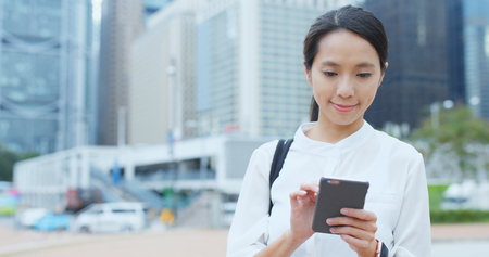 Confident businesswoman use of mobile phone