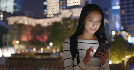 Woman looking at mobile phone at outdoor