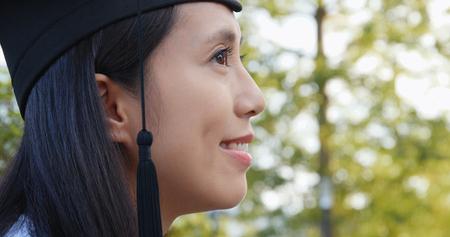 Side profile of woman get graduation Stock Photo