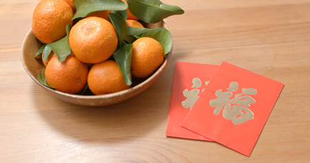 Mandarin orange for lunar new year with red packet chinese word means luck