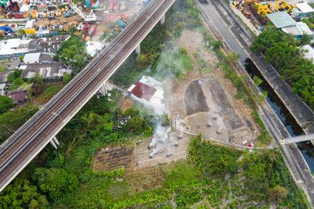 Tin Shui Wai, Hong Kong, 29 September 2018:- Hong Kong city with fire smoke burn in the field