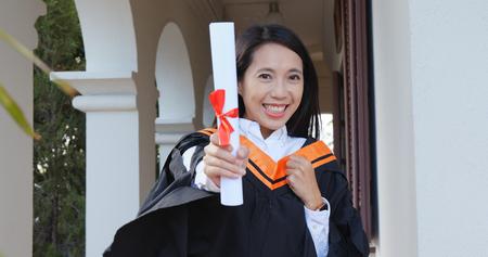 Graduation student holding certificate
