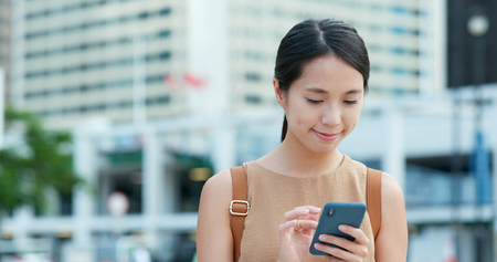 Woman using mobile phone online
