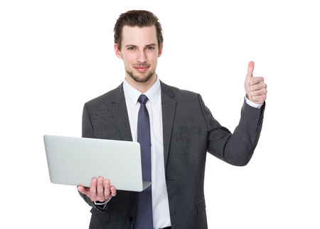 Confident businessman hold with laptop and finger point up