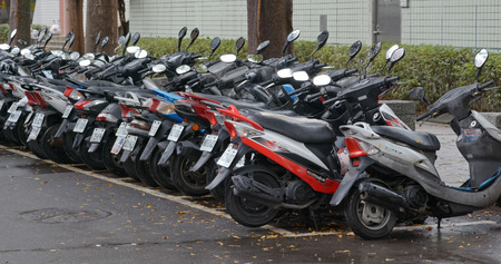 Taipei, Taiwan- 27 December 2018: Parking of scooter in city 新聞圖片