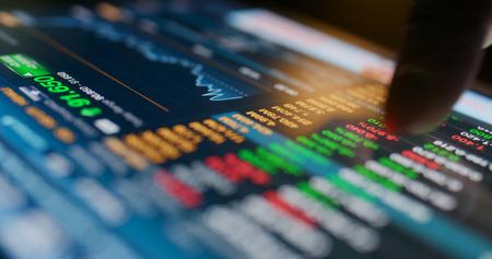 Stock market data graph on tablet Banco de Imagens