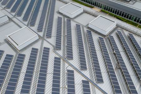 Top down view of Solar panel station on roof top building