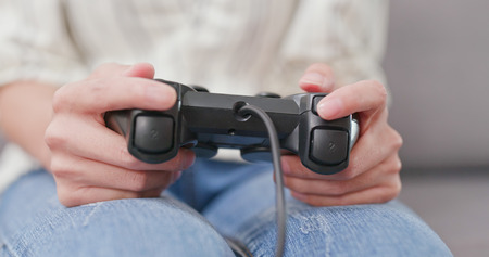 Woman playing video game at home