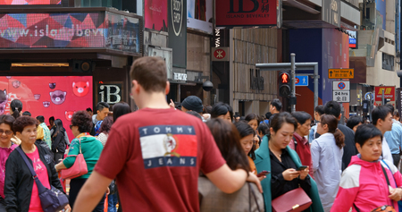 Causeway Bay, Hong Kong 16 March 2019: People walk in the street Editorial