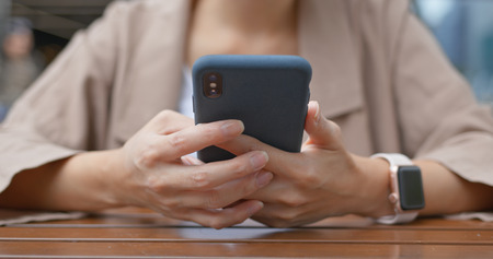 Woman use of mobile phone online