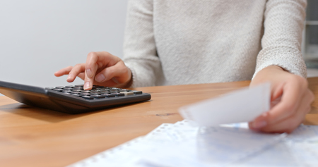 Woman calculate the expenditure of daily life
