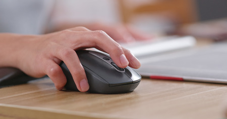 hand with mouse Stock Photo