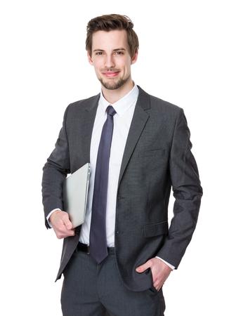 Geschäftsmann halten mit Laptop-Computer Standard-Bild