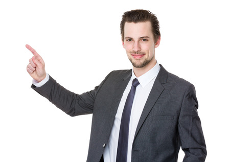 Caucasian young businessman with finger point up