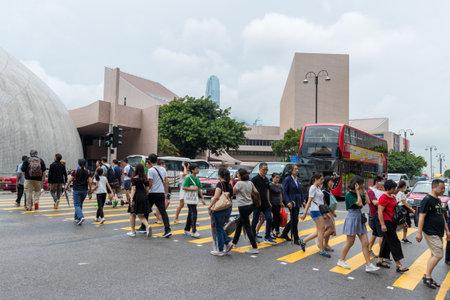 Tsim Sha Tsui, Hong Kong 17 August 2018:- People crossing the road Editorial