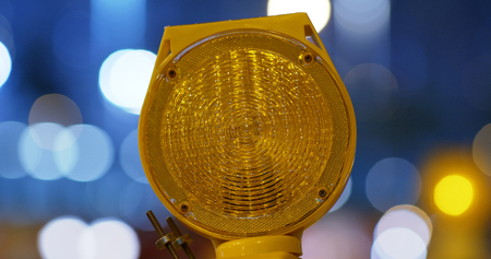 Yellow caution light at night