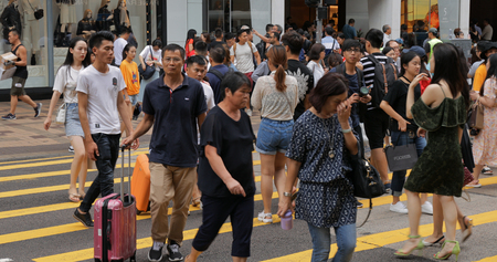 Tsim Sha Tsui, Hong Kong, 17 August 2018:- People crossing the road in the city Editorial