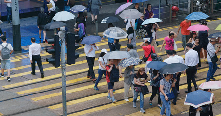 Central, hong Kong, 10 October 2018:- People cross the street in city at rain day