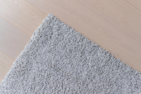 Grey carpet on the wooden floor 版權商用圖片