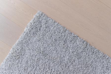Grey carpet on the wooden floor 写真素材