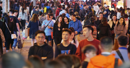 Causeway Bay, Hong Kong -22 February 2019: Crowded of People cross the road at night Editorial