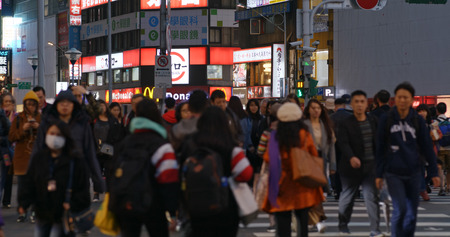 Taipei, Taiwan- 26 December 2018: People cross the road in Taipei city  at night Editorial