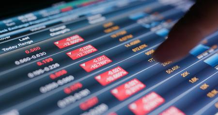 Tablet showing stock market data Banco de Imagens