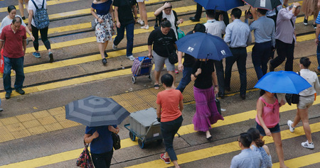 Central, hong Kong, 10 October 2018:- Top view of People cross the street in city at rain day Editorial