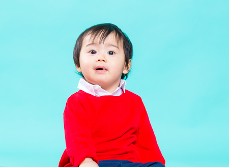 Little kid with red shirt Stock Photo