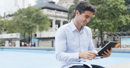 Man use of digital tablet at outdoor