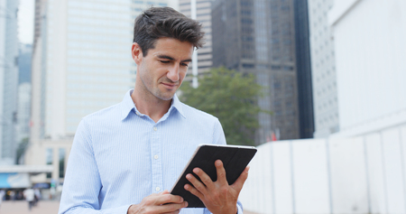 Businessman hold with tablet in city Standard-Bild