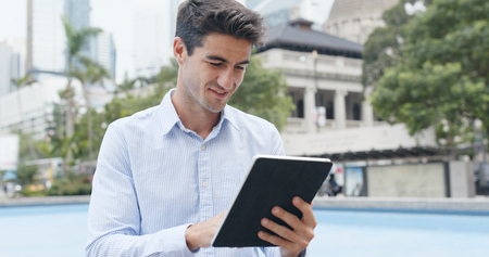 Man use of tablet at outdoor