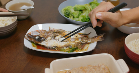 Couple have dinner together at home