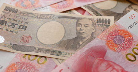 Chinese RMB and Japanese Yen banknote