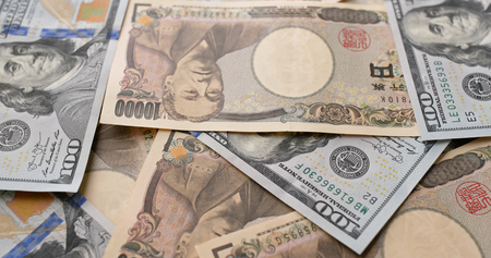 USD and Japanese Yen banknote