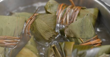 Cook with bamboo sticky rice dumpling