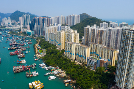 Drone fly over Hong Kong city with typhoon shelter Stock Photo