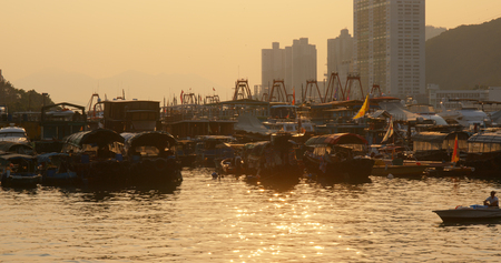 Aberdeen, Hong Kong 12 May 2019: Hong Kong fishing harbor port at sunset time