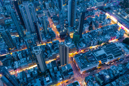Kowloon City, Hong Kong 17 May 2019: Top view of Hong Kong city at night Редакционное