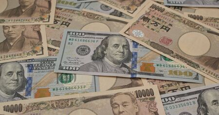 Stack of Japanese yen and USD