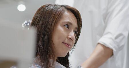 Woman having hair treament at hair salon