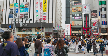 Tokyo, Japan, 25 June 2019: People cross the road in Ueno city street in Tokyo of Japan