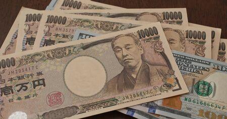 USD banknote and Japanese yen Reklamní fotografie