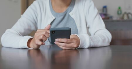 Woman use of smart phone at home