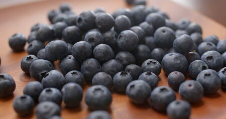 Heap of blueberry on wooden plate