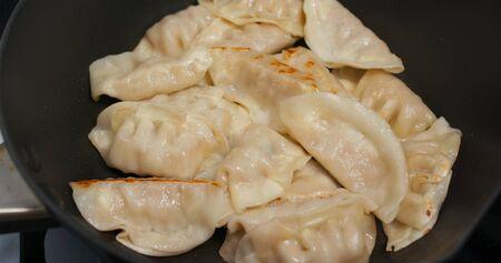 Fry meat dumpling on pan in kitchen