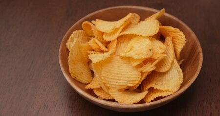 Eat potato chip in the party