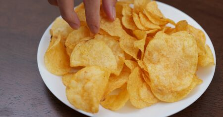 Eating potato chip together at home