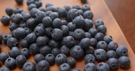 Stack of blueberry on the wooden plate Stock fotó