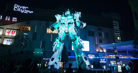 Tokyo, Japan 30 June 2019: Unicorn robot statue in odaiba at night